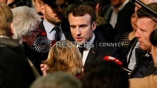 """French President Emmanuel Macron attends a meeting with local residents as part of the """"Great National Debate"""" in Bourg-de-Peage near Valence, France, January 24, 2019."""