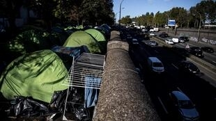 The makeshift camp along Paris's ringroad at the Porte d'Aubervilliers.