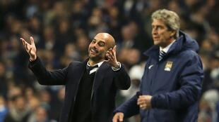 Manchester City's manager Manuel Pellegrini with Pep Guardiola