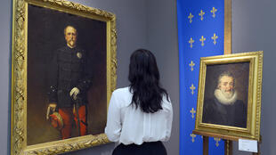Historical paintings of Henri d'Orleans (left) and French King Henri IV at Sotheby's auction house in Paris, 18 September 2015
