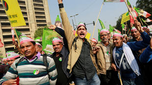 Farmers shout slogans during a rally to protest soaring farm operating costs and plunging prices of their produce, in New Delhi, India, November 30, 2018.