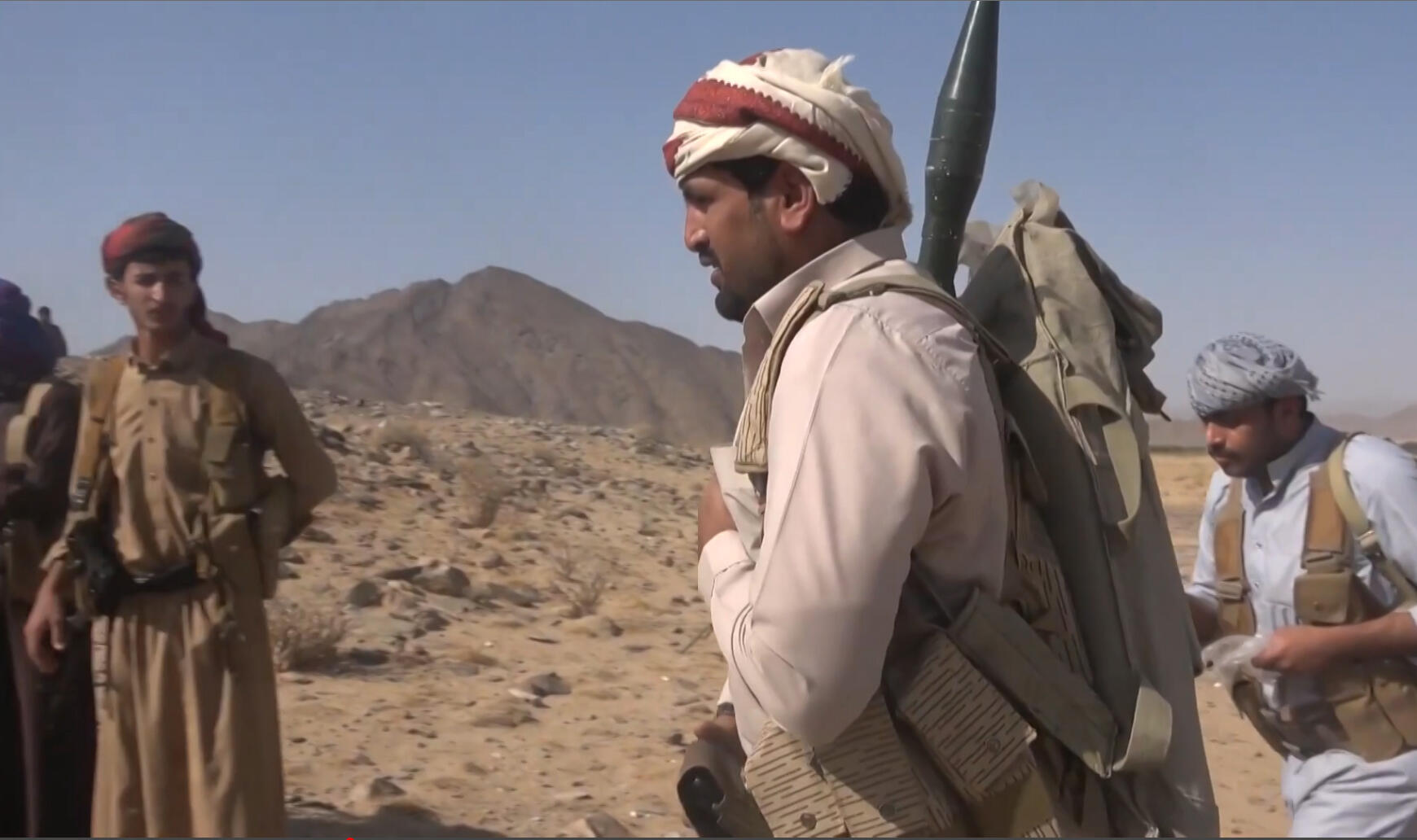 A grab from an AFPTV video shows Yemeni pro-government fighters on September 27