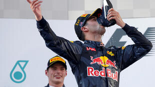 Daniel Ricciardo celebrated his first  win of the season in Malaysia with a 'shoey' - drinking champagne from his driving boot.