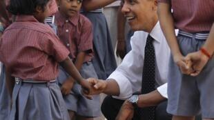 US President Barack Obama greets children while touring Humayun's tomb in New Delhi