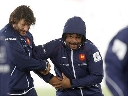 France rugby team players Mathieu Bastareaud (C) and Lionel Nallet attend a team training session at the Rugby Union National Centre in Marcoussis