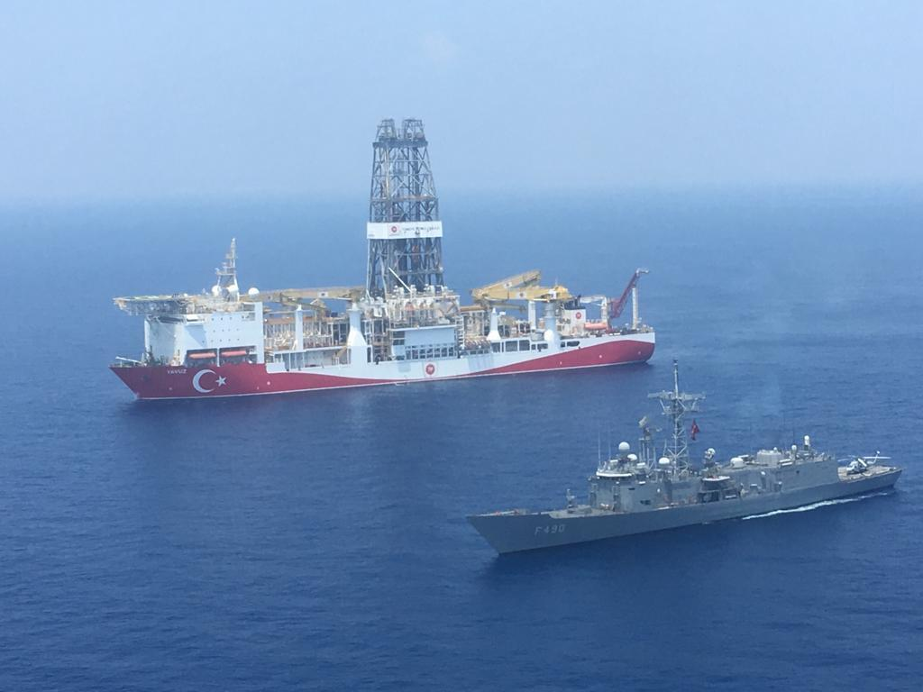 A Turkish Navy warship patroling next to Turkey's drilling ship 'Fatih' which made the major gas discovery in the Mediterranean