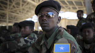 Somali National Army (SNA) soldiers sit during a passing-out ceremony in Mogadishu