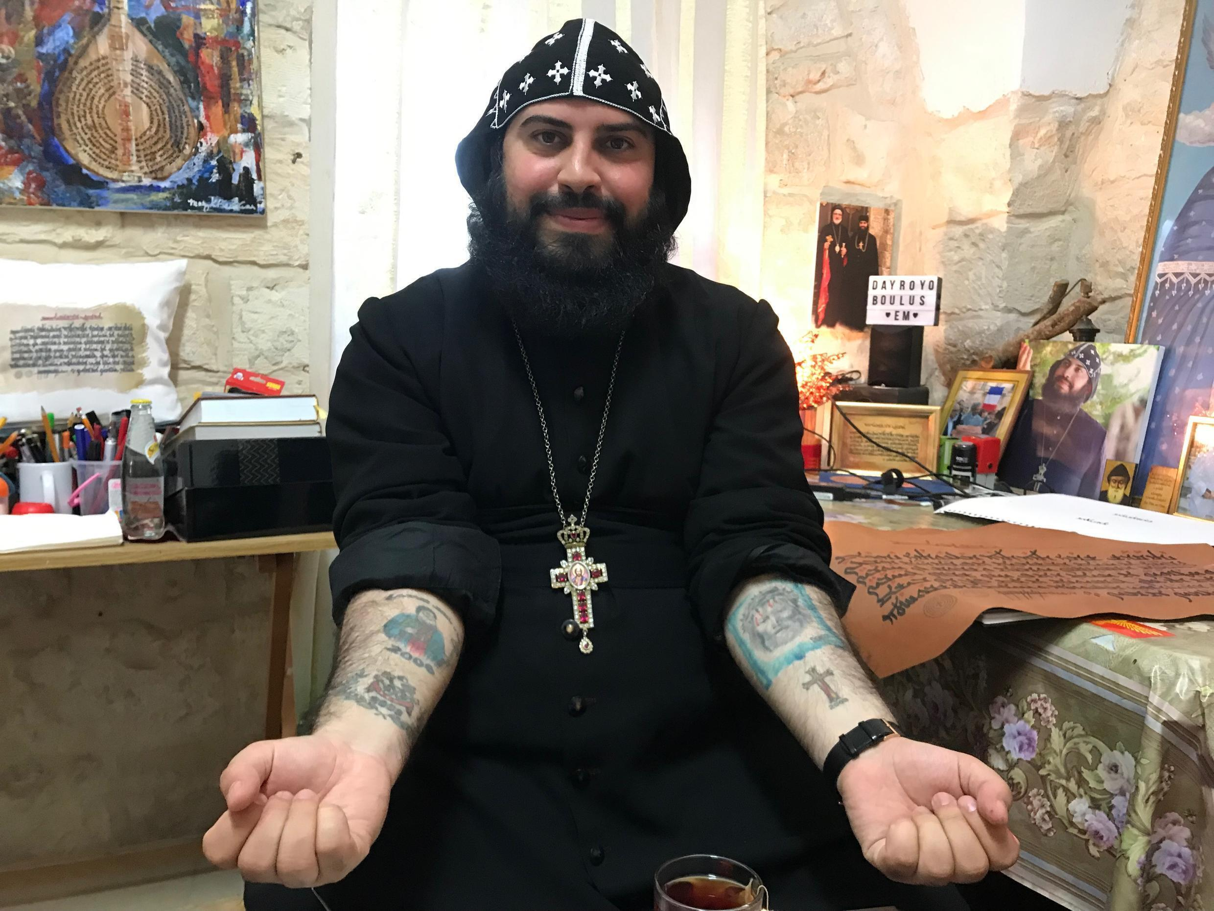 Father Bolus showing his coptic tattoos, Jerusalem