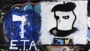 Un graffiti du logo et d'un militant de l'ETA, organisation séparatiste basque, qui a renoncé à son «activité armée» voilà cinq ans, jour pour jour.