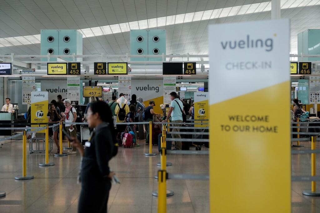 Les guichets d'enregistrement de la compagnie espagnole Iberia à l'aéroport El Prat de Barcelone le 27 juillet 2019.