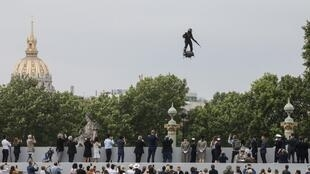 "French inventor Franky Zapata flies his jet-powered ""Flyboard"" down the Champs-Elysees at the Bastille Day parade in Paris 14 July 2019."