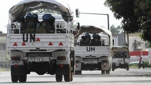 UN peacekeepers on patrol in the streets of Abidjan, 17 December 2010.