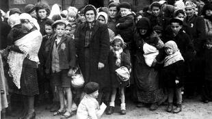 Jews awaiting their fate at the selection ramp, Auschwitz Concentration Camp, May 1944