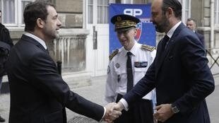 French Interior Minister Christophe Castaner (left) shakes hands with Prime Minister Edouard Philippe as Paris police Prefect Didier Lallement looks on.