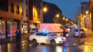 Police raid a flat in the Brussels district of Molenbeek after the attacks