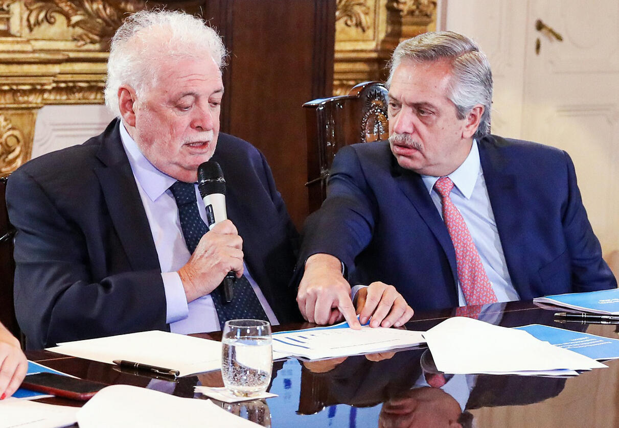 Argentina's President Alberto Fernandez (R) and Health Minister Gines Garcia at a cabinet meeting on tackling the coronavirus outbreak