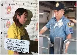 圖為外媒刊登中國女子因向菲警潑撒豆花遭刑拘圖片