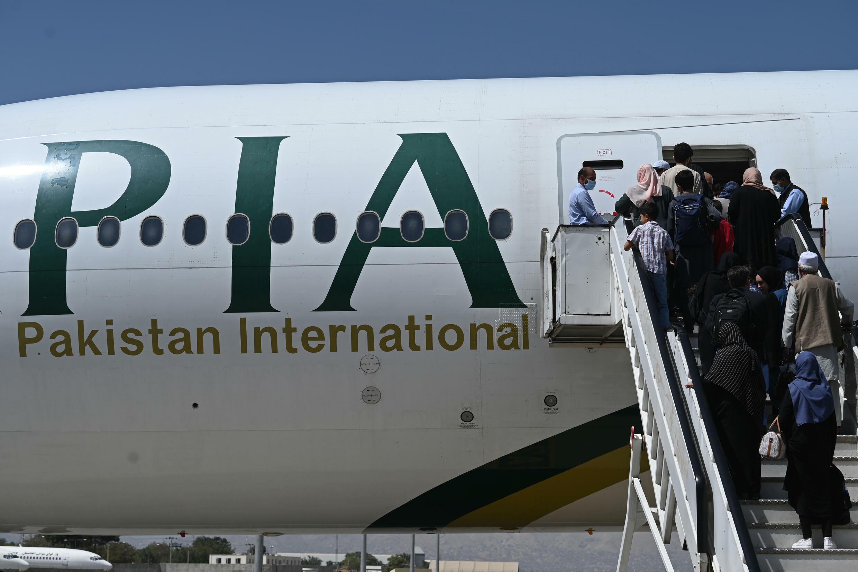 Passengers board a Pakistan International Airlines (PIA) flight at Kabul airport
