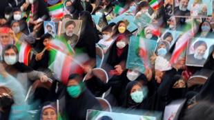 Adeptos del candidato iraní a la presidencia, Ebrahim Raisi, en las calles de Teherán el 14 de junio de 2021