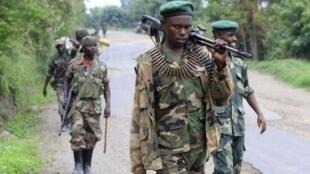 Des combattants du M23, le 3 août 2013, près de Rushuru, dans l'est de la RDC.