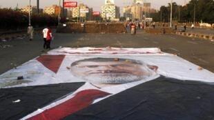Bango kubwa la Rais aliyeondolewa madarakani Mohamed Morsi mjini Cairo mwezi Agosti mwaka 2013.