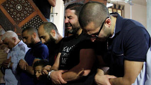 Relatives of the victims of the missing EgyptAir flight MS804 hold an absentee funeral prayer in a mosque nearby Cairo airport, in Cairo Egypt May 20, 2016.