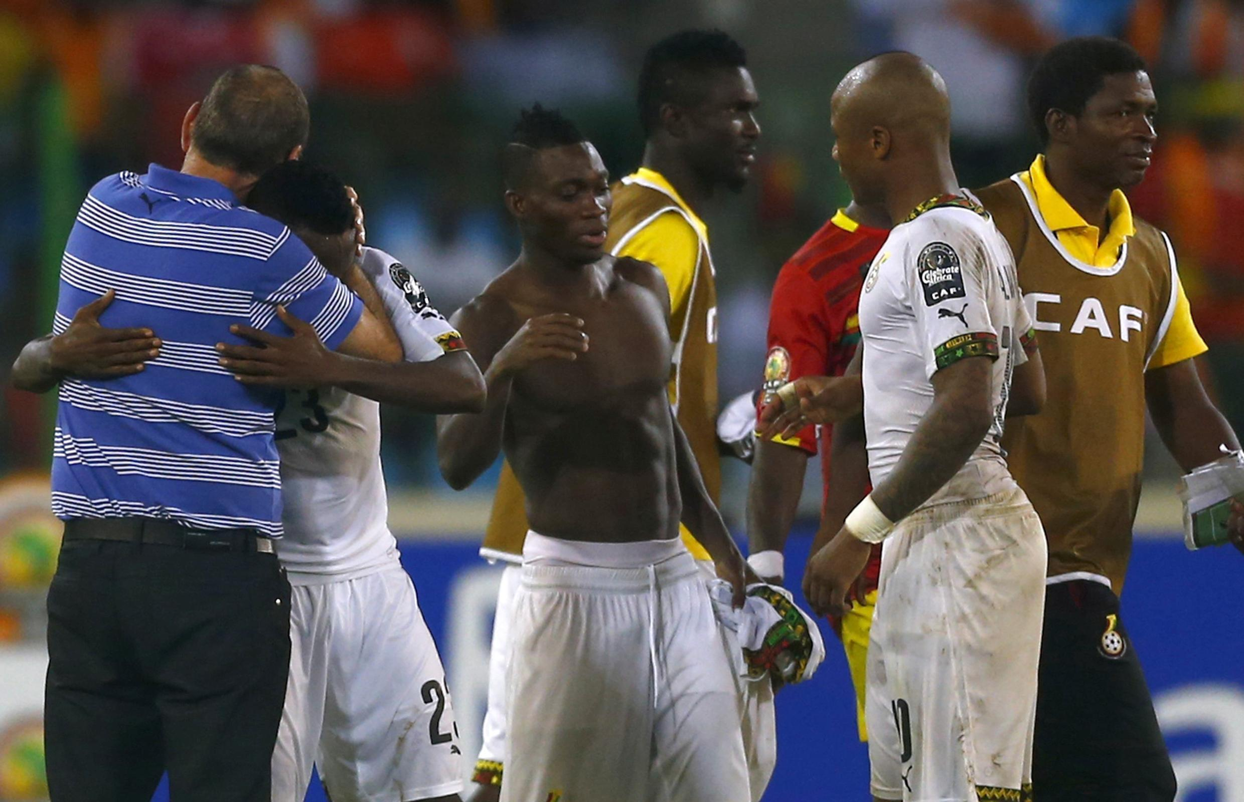Ghana's coach Avram Grant celebrates with his players after winning their quarter-final match againt Guinea