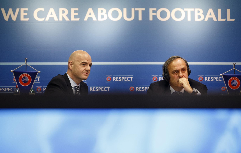 Rais wa Shrikisho la Soka Ulaya, Michel Platini (kulia) na katibu mkuu wa UEFA, Gianni Infantino.