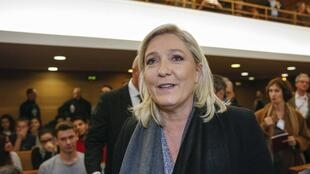French National Front political party leader Marine Le Pen arrives in court to face charges of making anti-Muslim remarks for her comparison of street prayers to a wartime Nazi occupation, in Lyon, France, October 20, 2015.