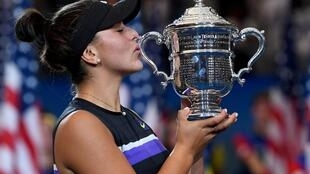 Bianca Andreescu of Canada wins the US Open championship trophy after beating Serena Williams, New York, 7 September 2019.
