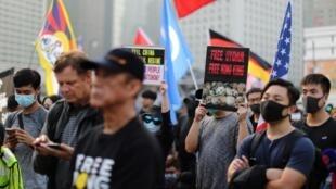 Người Hồng Kông biểu tình ủng hộ dân Duy Ngô Nhĩ tại Tân Cương ngày 22/12/2019.