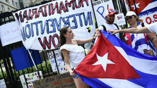 Crowds gather outside the Cuban embassy in Washington in support of anti-government protests in Cuba