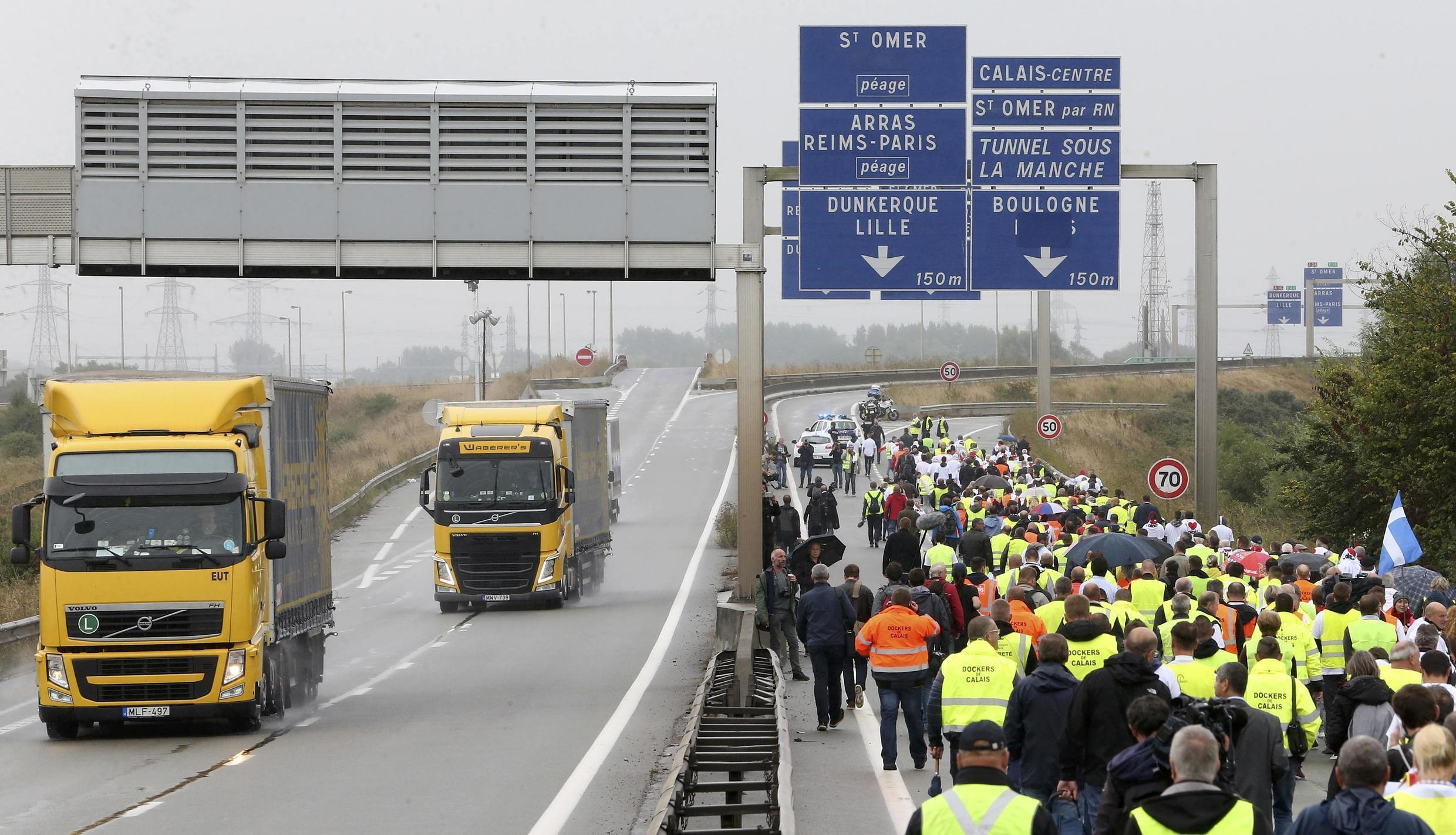 Harbour workers, storekeepers and residents marched on the motorway in protest against the migrant situation in Calais on 5 September, 2016.