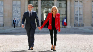 French President Emmanuel Macron and his wife Brigitte Macron walk toward the Elysee Palace courtyard, to welcome autistics people, prior to the launching of a program to enhance the diagnosis and treatment of autism, in Paris, France, July 6, 2017.