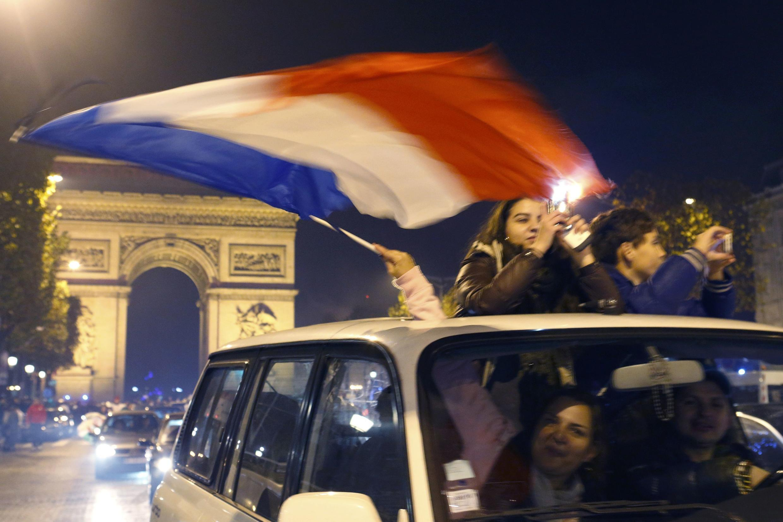 French fans celebrate on the Champs Elysées