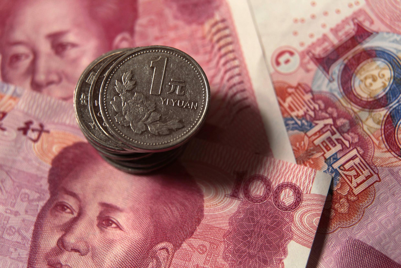 数字人民币可能取代印着毛像的纸币和金属钱币(资料图片)