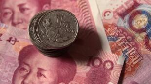 數字人民幣可能取代印着毛像的紙幣和金屬錢幣(資料圖片)