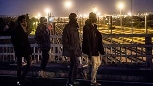 Migrants next to the Eurotunnel site in Calais, on28 July 2015.