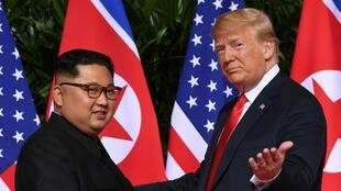 Saul Loeb, AFP | (FILES) In this file photo taken on June 12, 2018, US President Donald Trump (R) meets with North Korea's leader Kim Jong-un (L) at the start of their US-North Korea summit, at the Capella Hotel on Sentosa Island in Singapore.