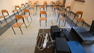 One metre apart: at Rome's Luigi Einaudi technical high school, staff have been setting up classrooms for pupils' return