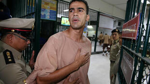 Jailed Bahraini footballer Hakeem Al Araibi arrives at Thailand's Criminal Court to submit his evidence to fight his extradition, after a local prosecutor submitted Bahrain's extradition request for him, in Bangkok, Thailand February 4, 2019