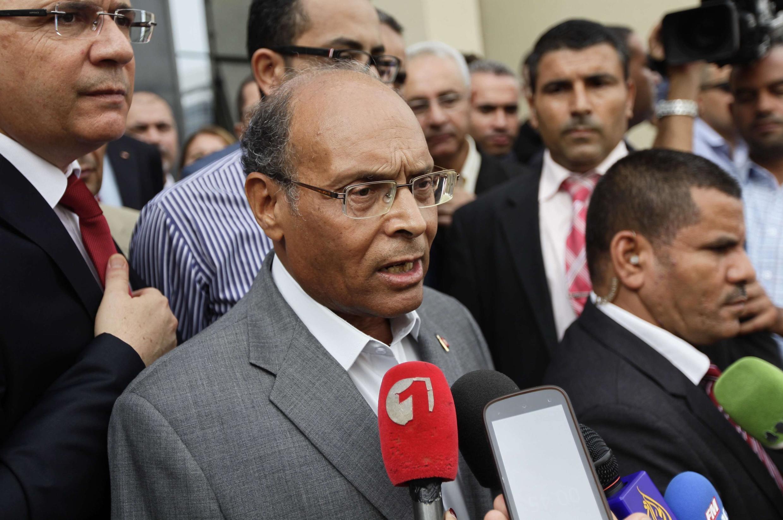 Moncef Marzouki a annoncé sa candidature à sa succession devant les médias, à Tunis le 20 septembre 2014.