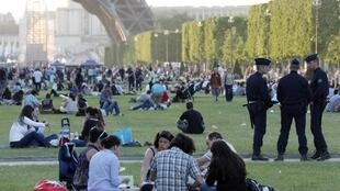 People picnicking along the Champs de Mars, Paris