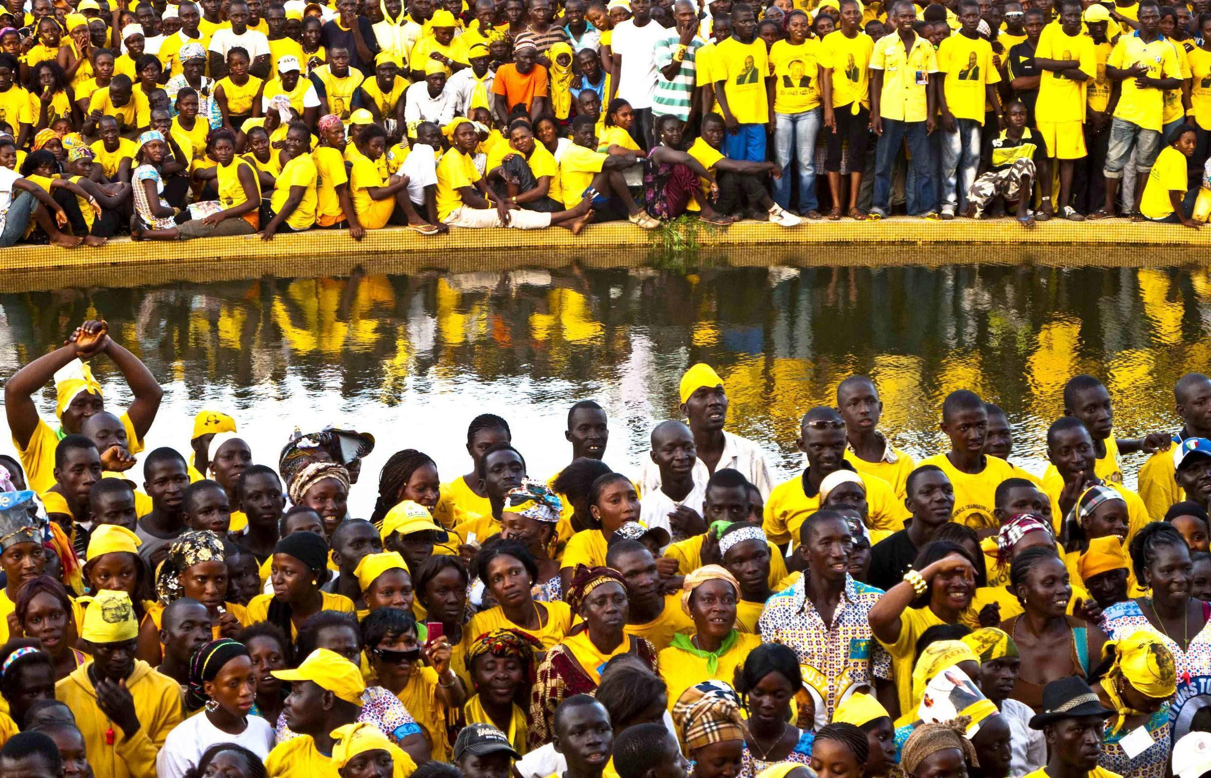 Supporters of presidential candidate Alpha Conde attend a campaign rally