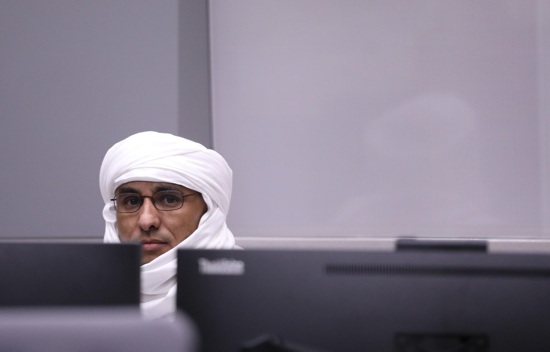 O  jihadista maliano  Al Hassan Ag Abdoul Aziz Ag Mohamed Ag Mahmoud  por ocasião da sua primeira audiência perante  o Tribunal Penal Internacional de Haia  em Julho de 2019.