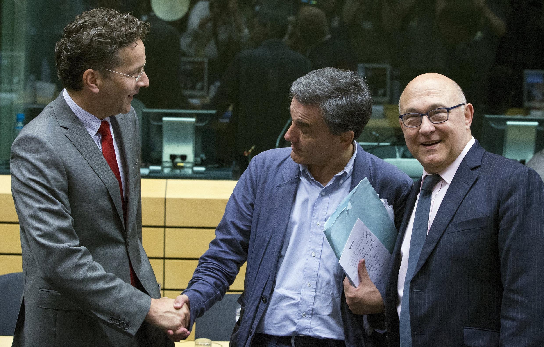 Eurogroup president Jeroen Dijsselbloem (L) with new Greek Finance Minister Euclid Tsakalotos and France's Michel Sapin this week
