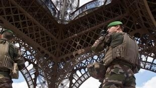 French soldiers defending the Eiffel Tower, Paris