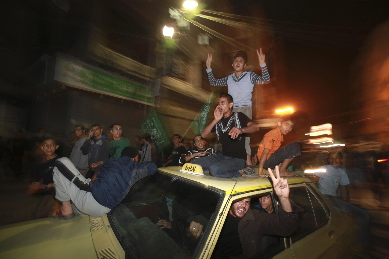 Người Palestine ở Gaza vui mừng nghe tin ngừng bắn ngày 21/11/2012.