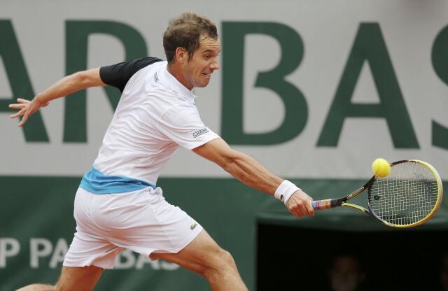 Richard Gasquet of France hits a return to Nikolay Davydenko of Russia