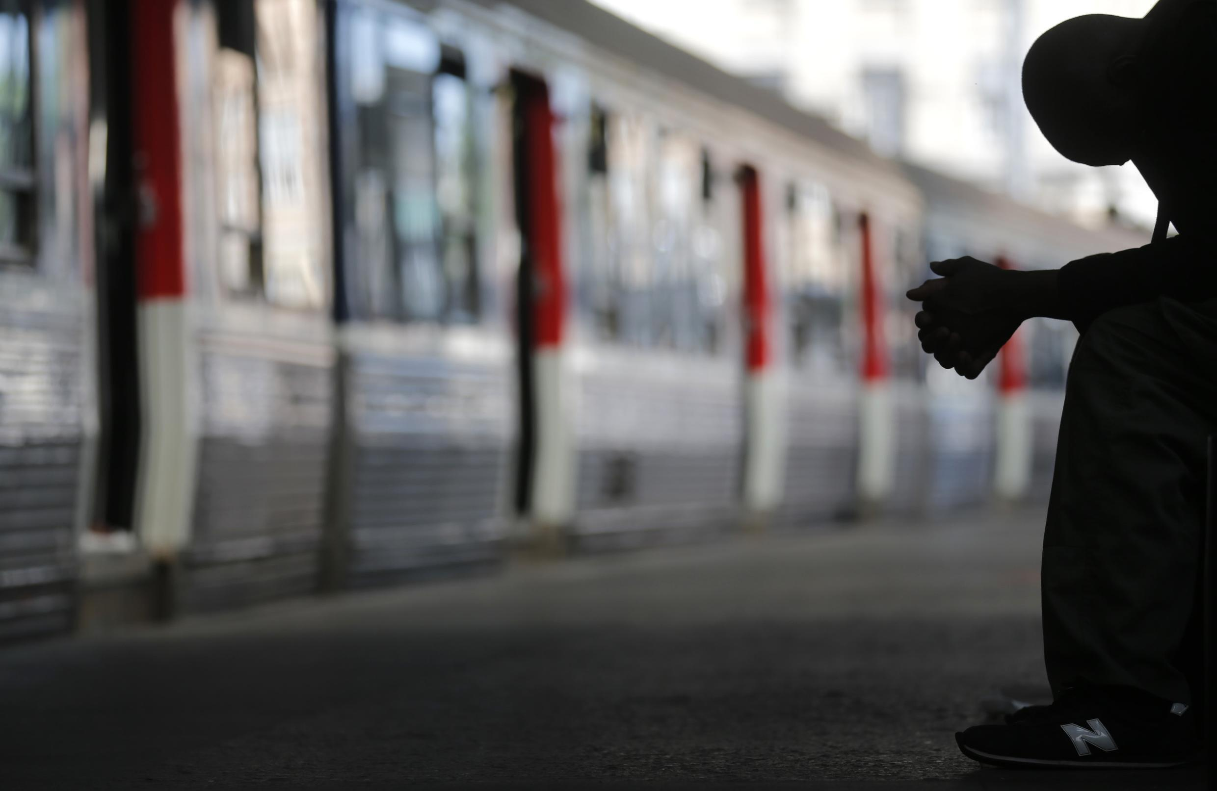 A commuter at Paris's Saint Lazare station on Wednesday